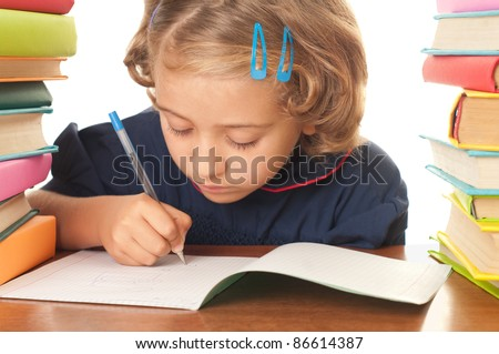 Blonde happy schoolgirl works on her homework, write something in her notepad, isolated on white - stock photo