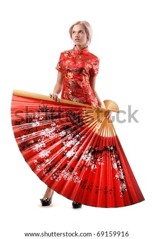 Blonde in a kimono with fan - stock photo