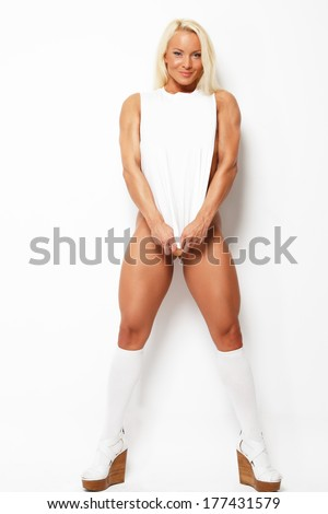 Blonde in a white shirt and knee-high boots - stock photo