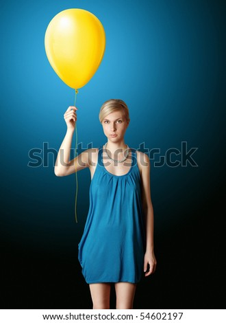 blonde in blue dress with the yellow balloon