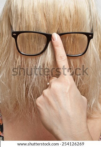 Blonde in glasses with closed face hair - stock photo