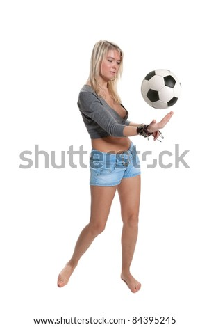 Blonde in shorts playing with Ball barefoot posing in studio isolated on a white background - stock photo