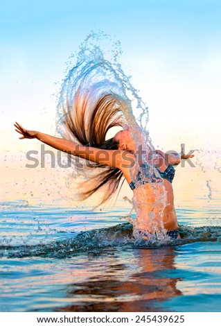 Blonde in the water waving hair - stock photo