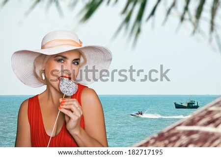 Blonde in white hat on the background of the sea. Collage. - stock photo