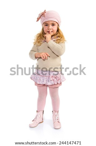 Blonde kid making silence gesture
