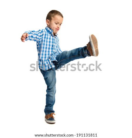 Blonde kid playing over isolated white background - stock photo