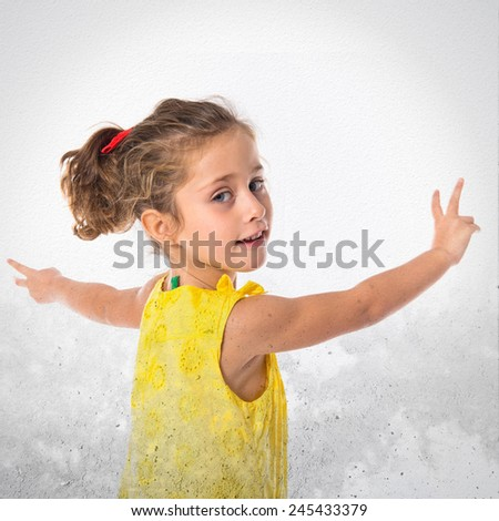 Blonde little girl dancing over textured background - stock photo
