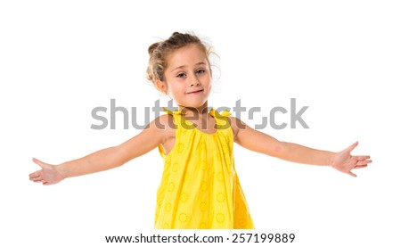 Blonde little girl dancing over white background - stock photo