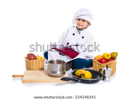 Blonde little girl dressed like chef - stock photo