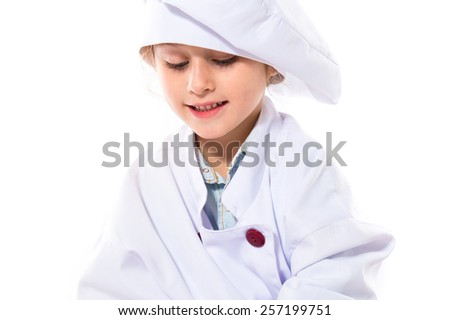 Blonde little girl dressed like chef
