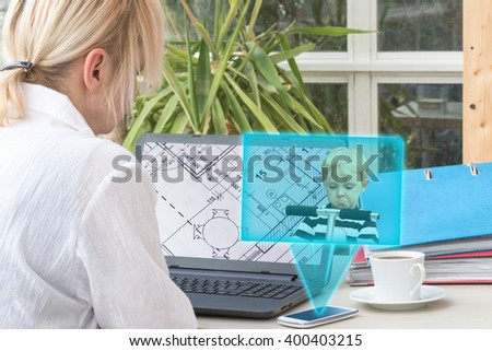 Blonde middle aged woman has open a blueprint in a laptop screen. Smart phone is radiating transparent rectangle with a picture of angry blond boy standing on the scooter. - stock photo