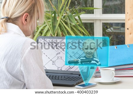 Blonde middle aged woman has open a blueprint in a laptop screen. Smart phone is radiating transparent rectangle with a picture of smiling blond boy standing on the scooter. - stock photo
