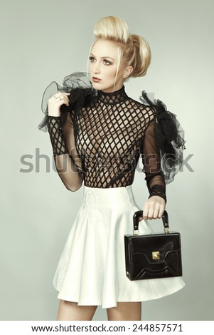 Blonde model in black and white with little suitcase