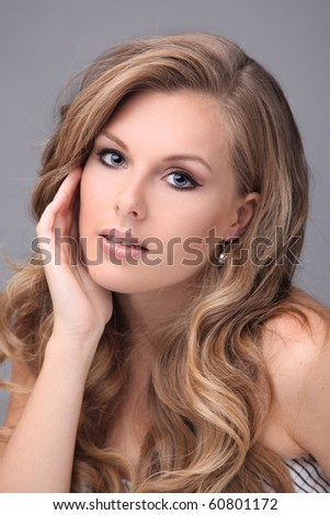 blonde  model with beautiful hair in studio - stock photo