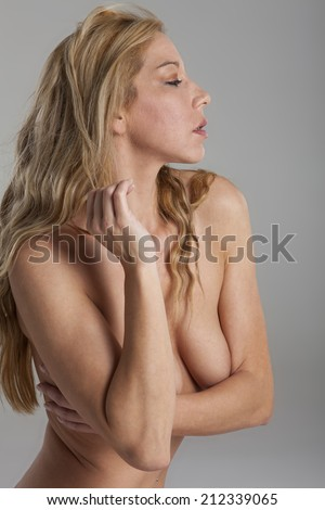 blonde naked woman on grey background  - stock photo