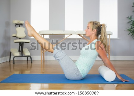 Blonde patient doing exercise on the floor in bright room
