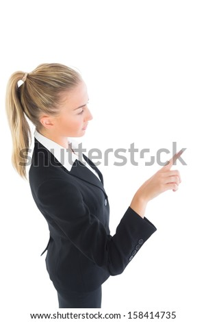 Blonde pony tailed business woman pointing on white background