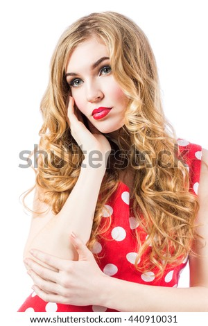 Blonde sexy girl in a red dress with beautiful hair close-up portrait on a white background.