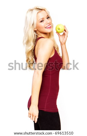 blonde sexy woman smiling holding fresh green apple - stock photo