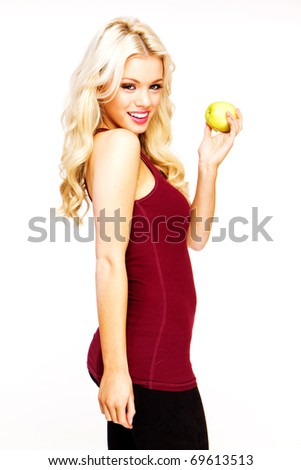 blonde sexy woman smiling holding fresh green apple