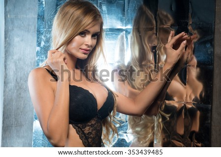 Blonde sexy woman with perfect slim body posing in sensual lingerie. Girl with long hair.  - stock photo