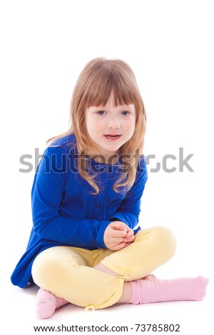 Blonde shy little girl sitting looking at camera