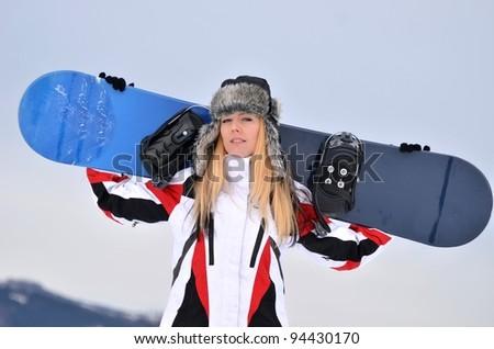 blonde snowboarder on snow - stock photo