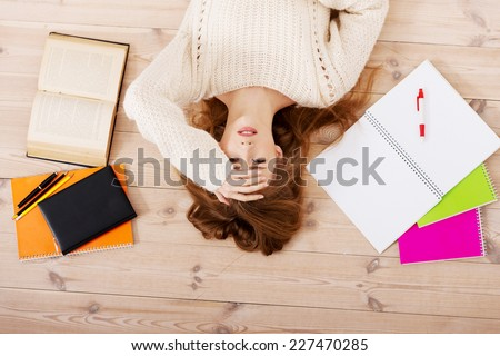 Blonde student worried about exams - stock photo