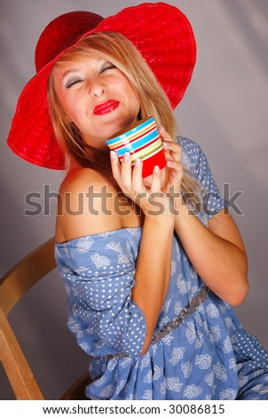 Blonde teenaged girl drinking coffee from ceramic cup - stock photo