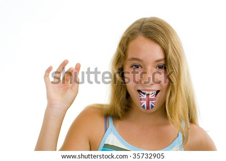 blonde teenager girl with british flag on tongue, isolated on white - stock photo