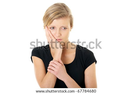 blonde unhappy female holds her cheek, toothache, studio shoot isolated on white - stock photo
