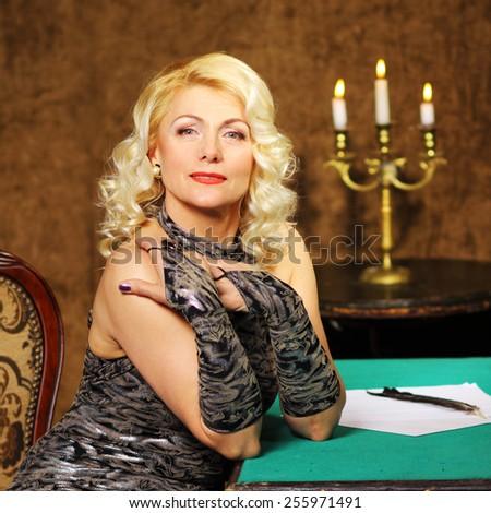 blonde Vintage fashion Senior woman in vintage evening dress. Beautiful woman retro portrait - stock photo