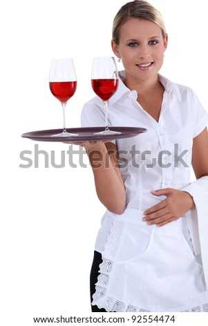 Blonde waitress with a tray - stock photo