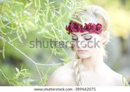 Blonde Wearing A Flower Cown - stock photo