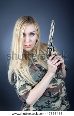 Blonde with a revolver - stock photo