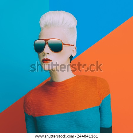 Blonde with fashionable hairstyle and sunglasses on bright background. Fashion photo - stock photo