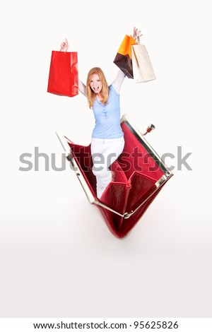 blonde with shopping bags jumping out of purse - stock photo