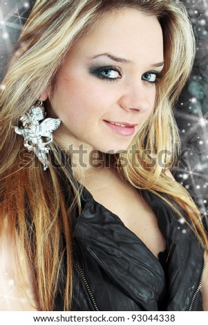 blonde with the fastening in the form of the angel - stock photo