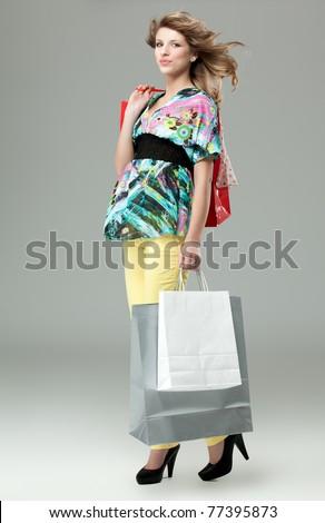 blonde woman carrying shopping bags high heels - stock photo