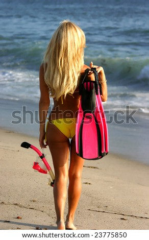 Blonde Woman going Snorkeling in San Clemente - stock photo