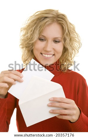 Blonde woman holding an envelope - stock photo