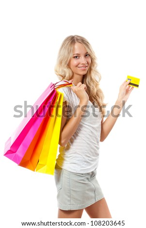 blonde woman holding card and bags over white - stock photo