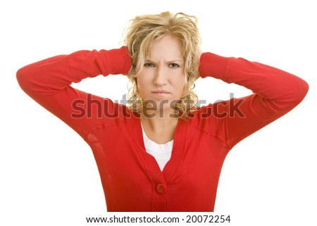 Blonde woman holding her ears - stock photo