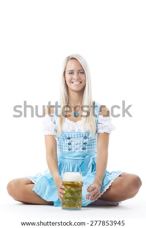 blonde woman in a bavarian dirndl  - stock photo