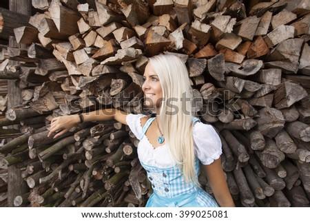 blonde woman in a bavarian dirndl  - stock photo