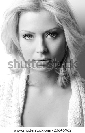 blonde woman in cozy white sweater - stock photo