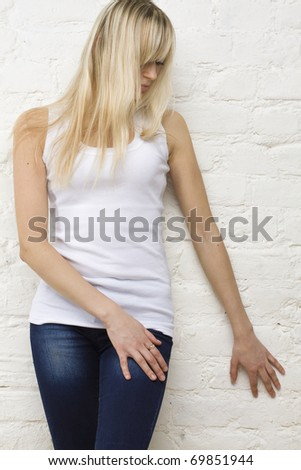 Blonde woman in white t-shirt. Pent-up passion - stock photo