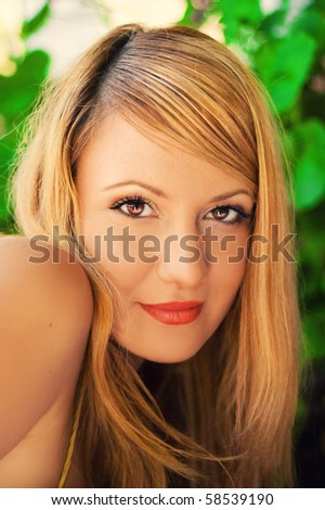 Blonde woman looking at the camera - stock photo