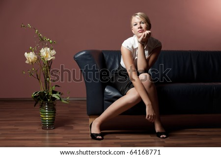 blonde woman on a couch - stock photo