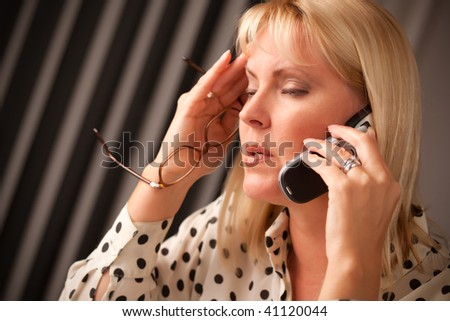 Blonde Woman on Her Cell Phone with Stressed Look on Her Face. - stock photo